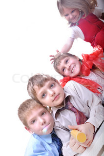 group of happy 3-7 year old kids playing on the floor