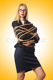 Woman businessman tied up with rope