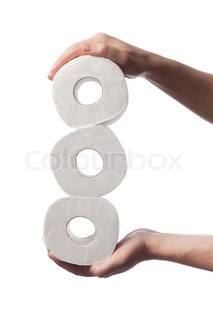 Man holding three rolls of white toilet paper in his hands.