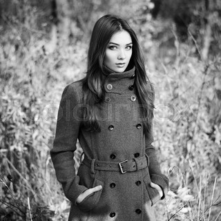 Portrait of young beautiful woman in autumn coat