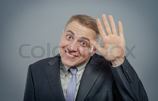 Closeup portrait of happy bashful socially awkward young man waving with hands, isolated. Positive emotion facial expression feelings, situation, reaction