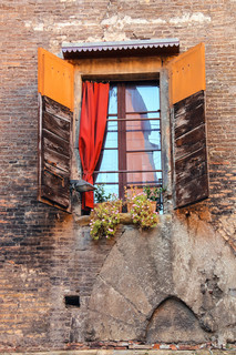Window with shutters in old Italian house