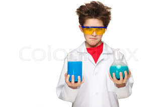 Little boy as chemist doing experiment with chemical fluid in the laboratory
