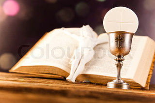 First communion, bright background, saturated concept
