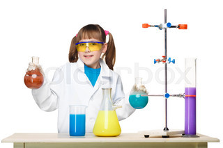 Little girl as chemist doing experiment with chemical fluid in the laboratory