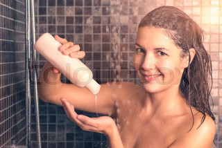 Woman Taking Shower Pouring hair shampoo on her Hand