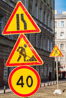 Speed limit, under construction and narrowing of the road