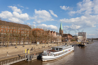 BREMEN, GERMANY - APR 5: Waterfront promenade at the Weser river in Bremen. April 5, 2015 in Bremen, Germany