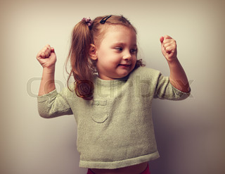 Happy smiling kid girl showing muscular and looking fun. Vintage portrait