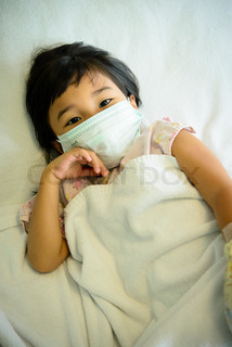 Kid sick in the hospital with mask