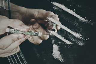 the man's hand and cocaine