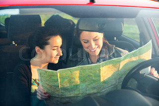 Friends in car enjoy road trip.