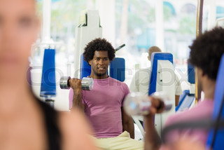 young people training and working out in fitness club