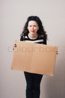 A woman holds a blank kraft paperboard. Gray background