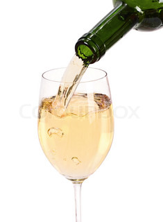 White wine being poured into a wine glass.Isolated on white