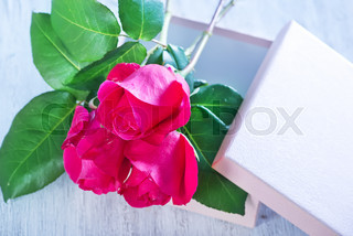 box for present and red roses