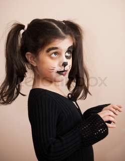 Beautiful  girl with face painting of dog