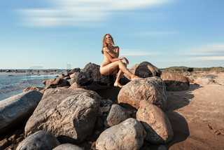 nude woman by the sea