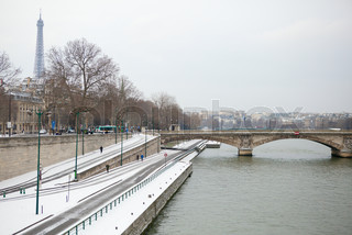 Winter in Paris. View of the embankments covered with snow