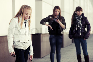 Teenage school girl with a cell phone
