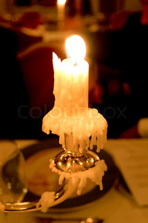 Crying silver candle, bright, xmas, romantic dinner