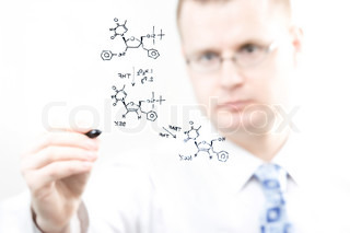young chemist writing organic chemistry reaction equation, selective focus