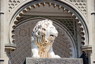 Sculpture of a lion in an arch aperture at an input in a palace