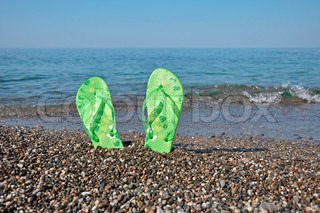 Holiday at the seaside - flip-flops on beach