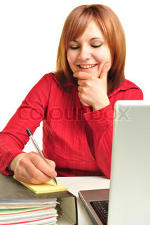 a young woman sitting at her office desk