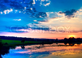 Image of 'background, Blue, sunset; cloud; sky; sunlight; sun; color; scene; nature; yellow; horizon; orange; twilight; over; outdoors; tranquil; copy; dusk; blue; beauty; space; form; travel; night; light; heaven; area; swirl;'