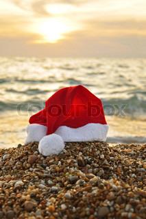 Santa Claus hat on the beach