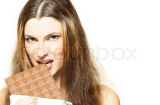 young attractive woman eating chocolate, over white
