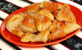 appetizing homemade baked cheese pastry on red plate