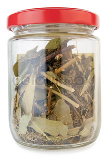 Small old dusty glass jar with spices macro isolated on white with patch