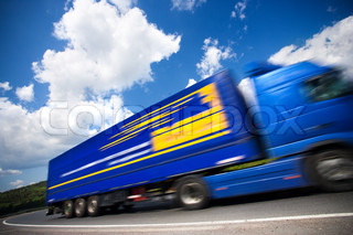 fast moving blue truck, motion blur. 16mpix