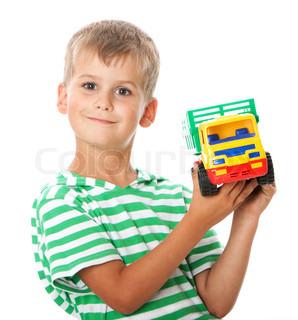 Boy holding car  isolated on white background