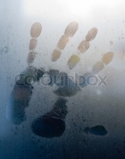 imprint of a person's palm to sweaty glass