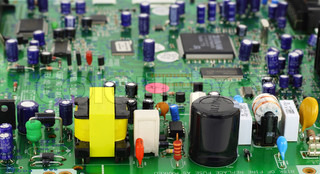 The modern printed-circuit board with various electronic components. In the foreground power supply components. Selective focus.