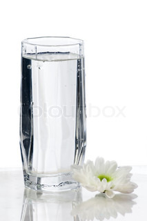 Glass of fresh water with flower isolated on white