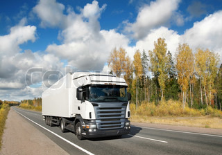 white truck on golden autumn country  highway, landscape