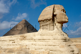 Sphinx on the background of great pyramid in Egypt