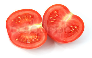 cut tomato with shadow. A ripe vegetable with drops of dew.