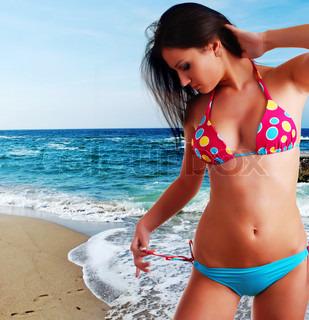 beautiful young woman in bright swimwear at the beach
