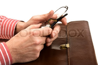 hands holding glasses and leather folder isolated on white background