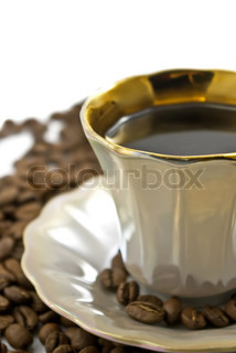 Cup of coffee with beans on the white
