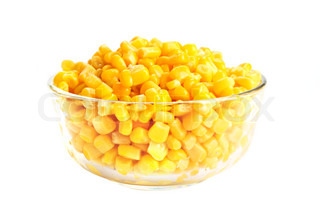 Canned corn in glass bowl isolated on white