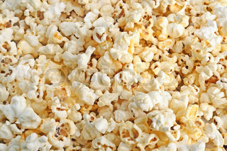 Background from salted fluffy fresh popcorn grains