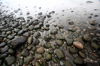 stones in the water in denmark on the north coast of the seeland island