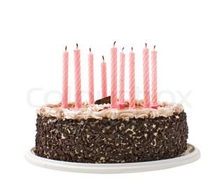 kage chokolade og stearinlys isoleret på hvid baggrund
