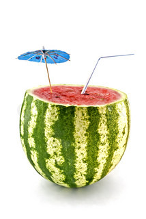water-melon with parasol and straw against white background